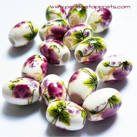 Perle ovale céramique blanche fleur rose 10mm