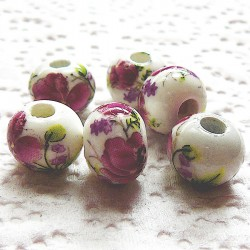 Perle ronde céramique blanche fleur rose 12mm